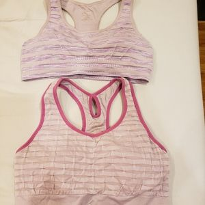 2 Pink racer back sports bras with nice design